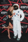 Candice Swanepoel and her date the Axe Astronaut at the ESPN Super Bowl Party