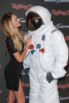 Candice Swanepoel and her date the Axe Astronaut at the Rolling Stone Super Bowl Party