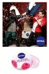 Mark Ballas and Travis Garland having a pillow fight in the NIVEA Lip Butters photo booth